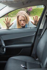 Woman locked out of car, keys shown on car seat locked inside