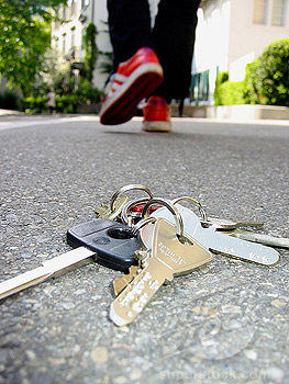 Keys dropped on floor, owner walking away without realising